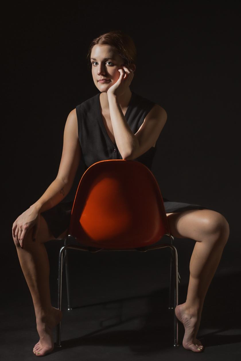 Ellen sits_